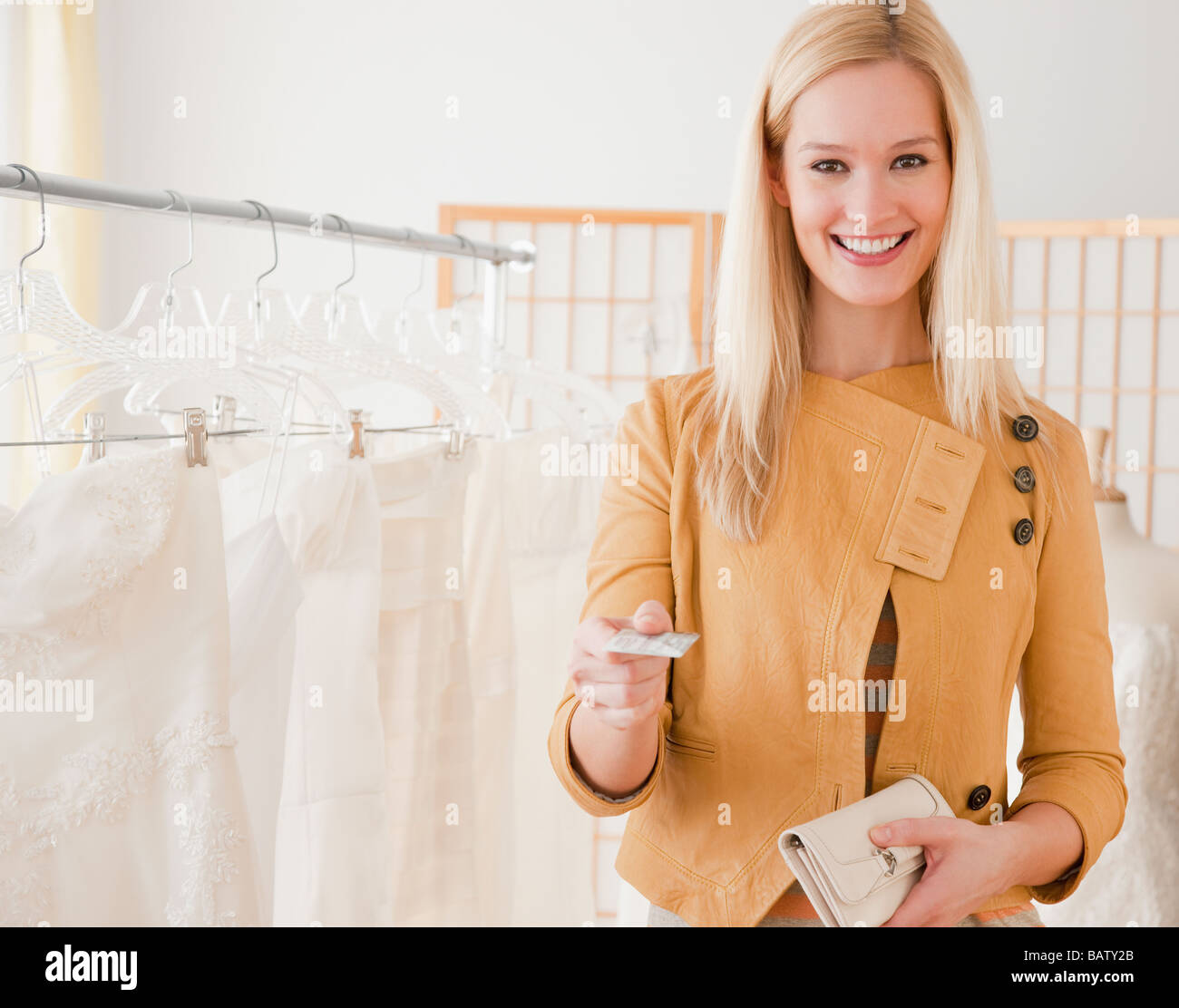 Portrait of young woman paying for wedding dress in bridal for Paying for a wedding dress