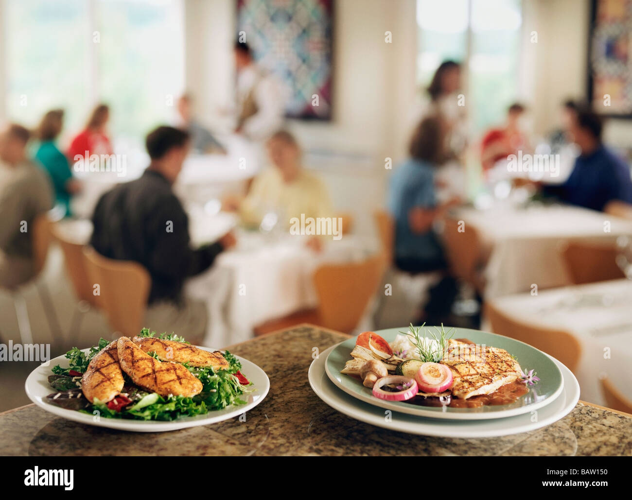 Restaurant Background With People plates with food on bar counter in restaurant, people in