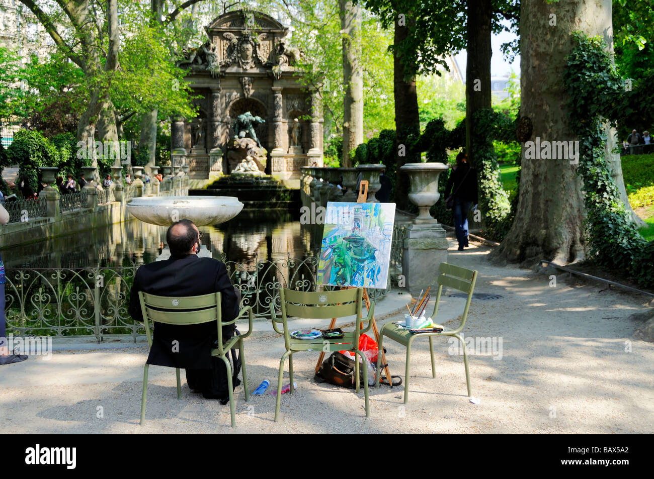 jardin du luxembourg paris france man painting at fontaine de stock photo royalty free image. Black Bedroom Furniture Sets. Home Design Ideas