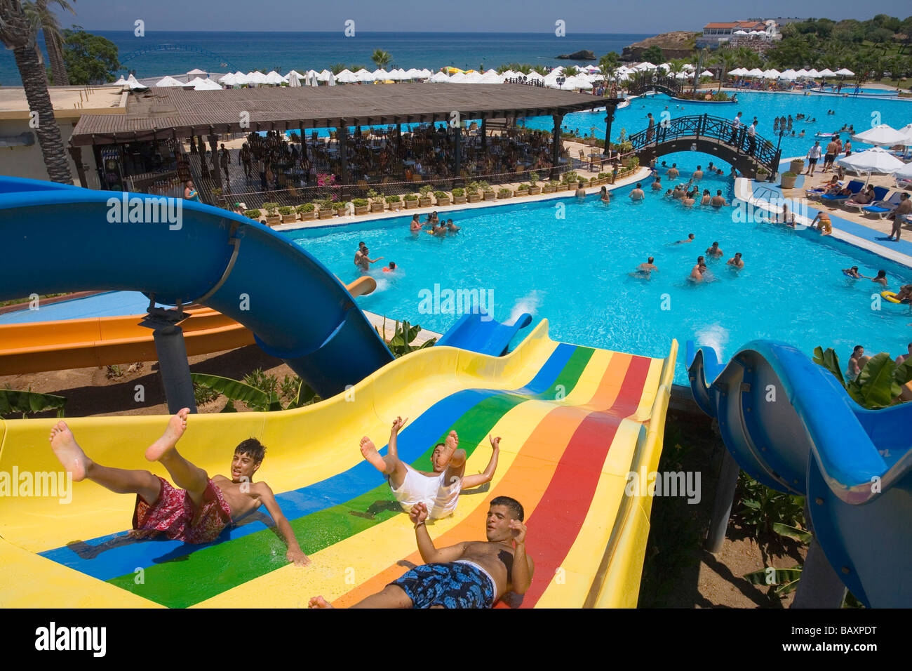 Three young men on a water slide, water park, Acapulco Beach Club ...