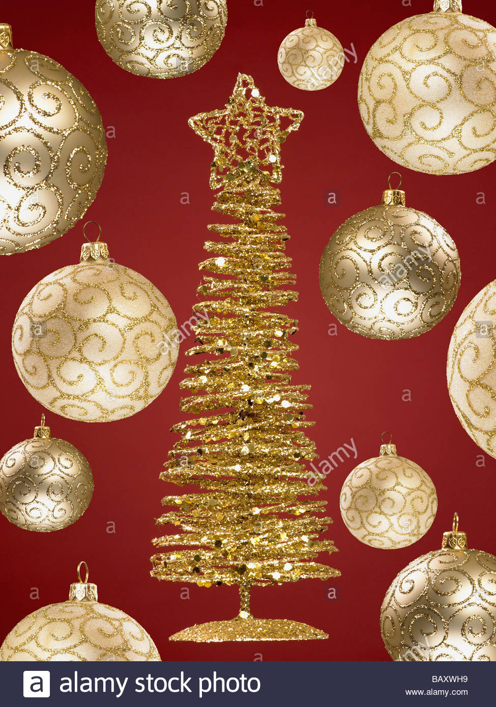 Close up of gold christmas ornaments and small tree stock for Small gold christmas ornaments