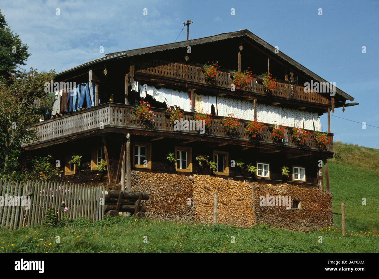 Laundry Drying On A Balcony Of An Old Log Cabin Style Farm