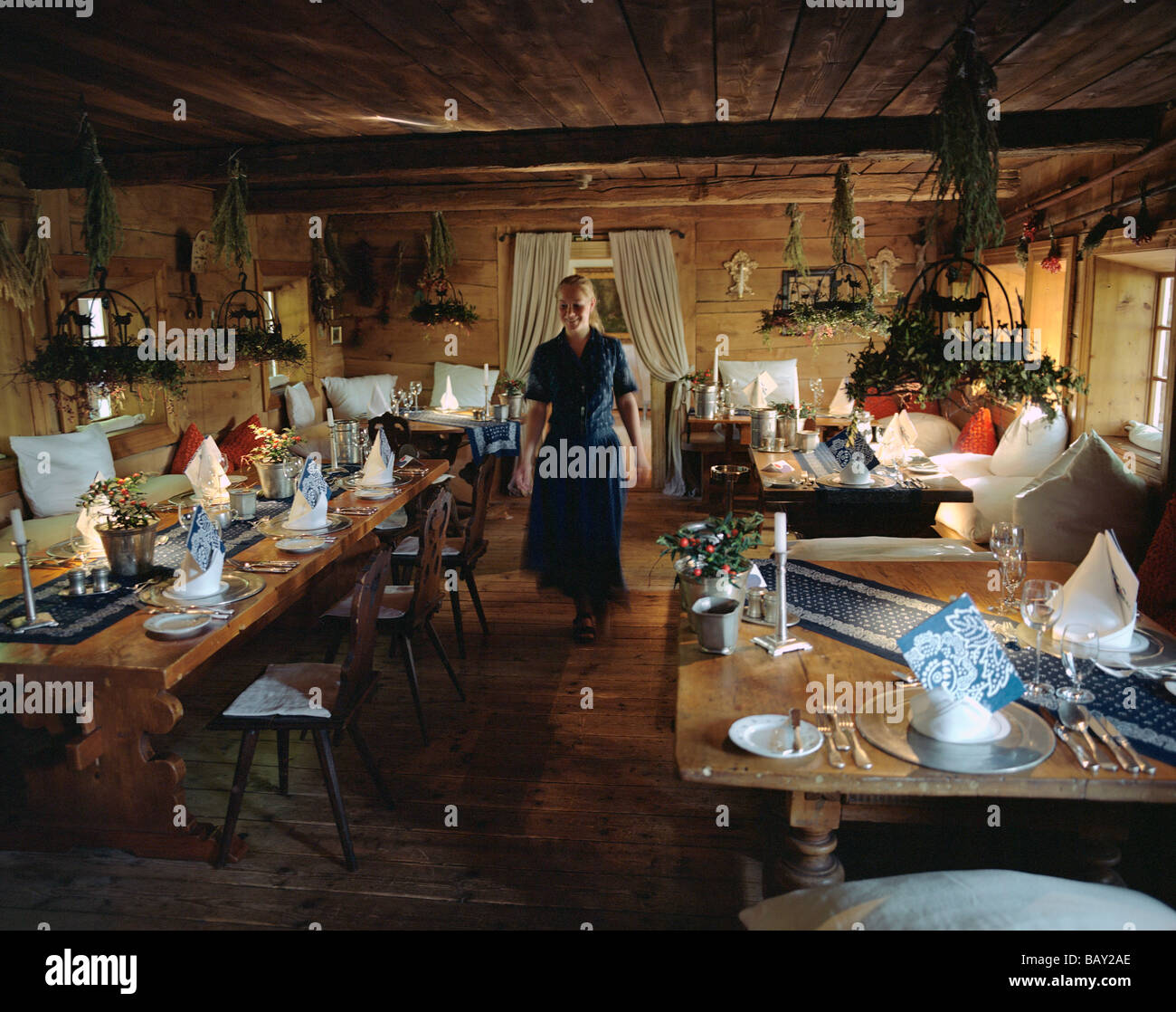 waitress in an old style restaurant fischerstuebchen part of hotel stock photo royalty free. Black Bedroom Furniture Sets. Home Design Ideas