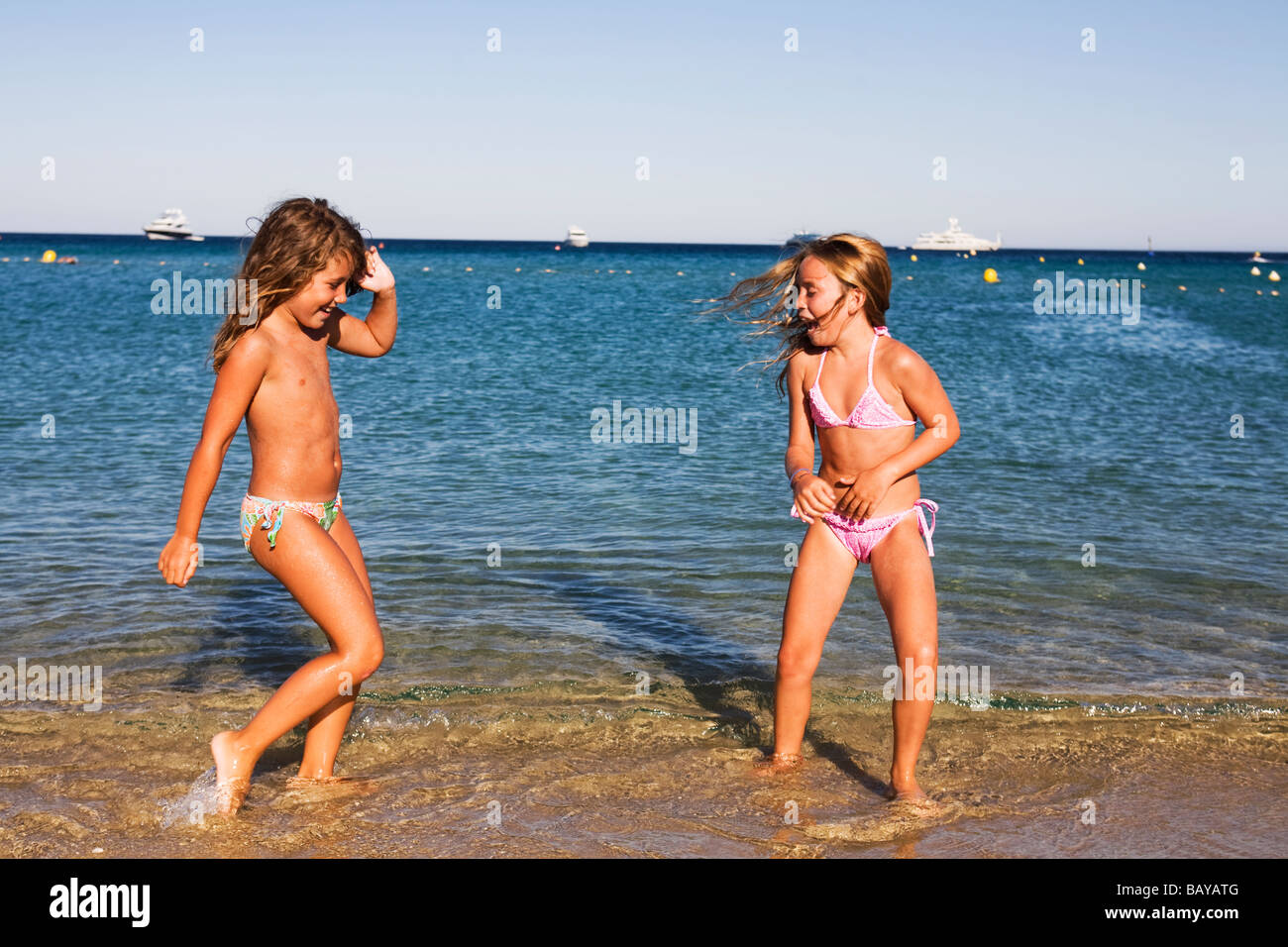 little girls naked on beach