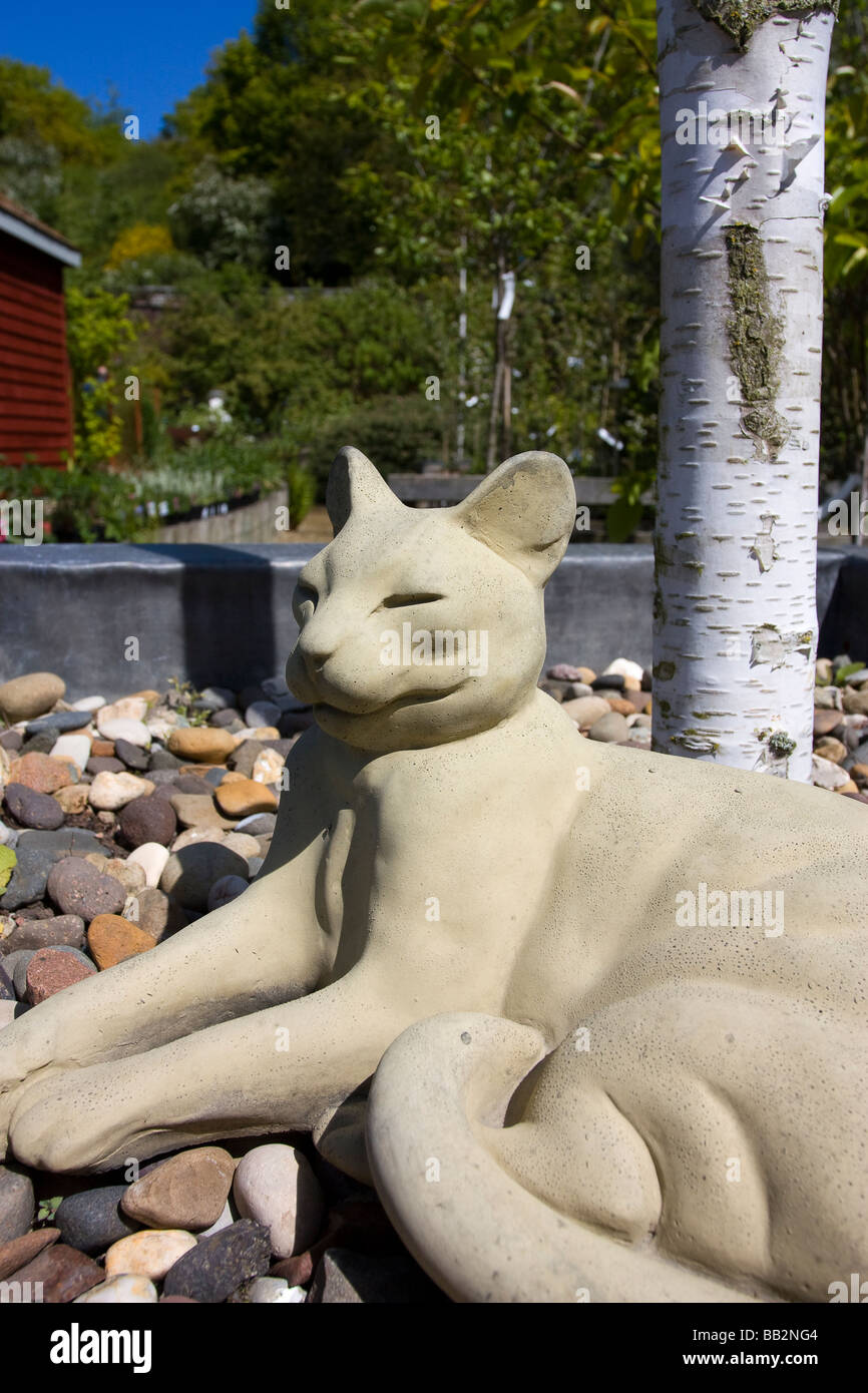 Stone Or Cast Concrete Garden Ornament Cat Relaxing In The Sun At The Base  Of A