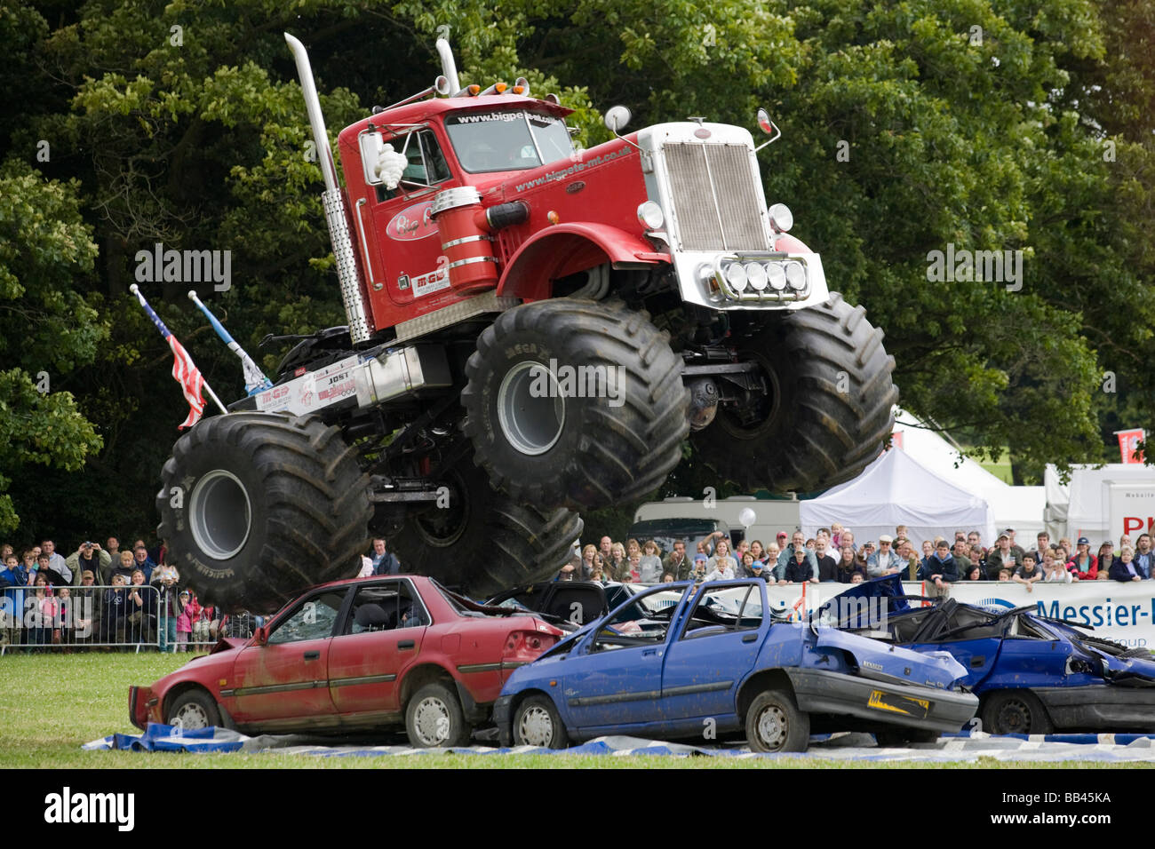 Monster Trucks Crushing Old Cars At A Farm Show Gloucestershire
