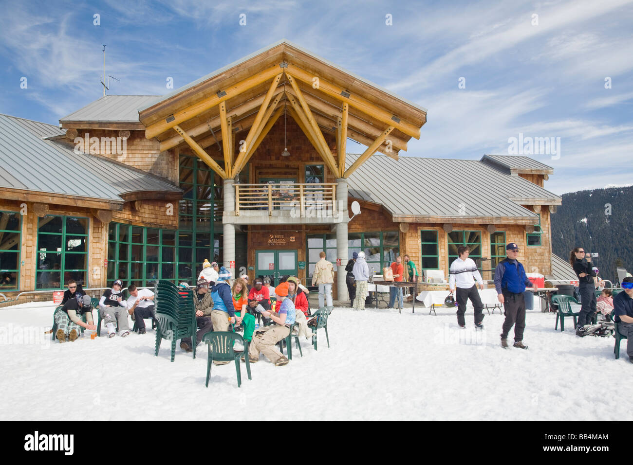 Stock Photo   WA, Mount Baker Ski Area, White Salmon Lodge, Snow Boarders  And Skiers On The Outdoor Patio