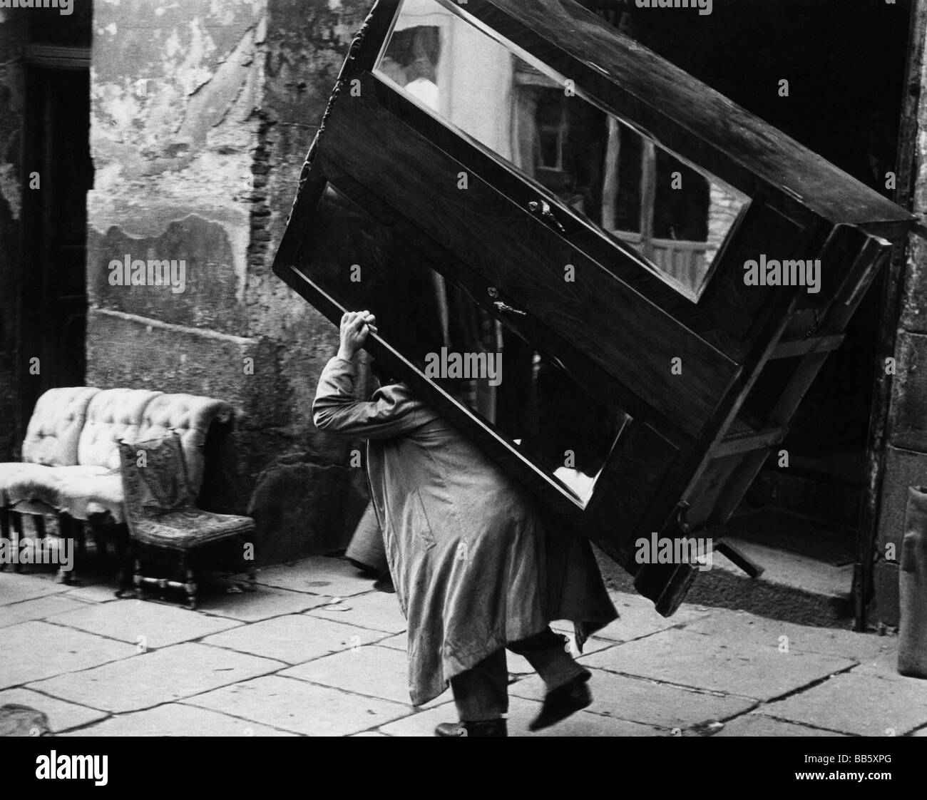 Oddity Man Carrying Armoire 1950s Curiosity Oddities Removal