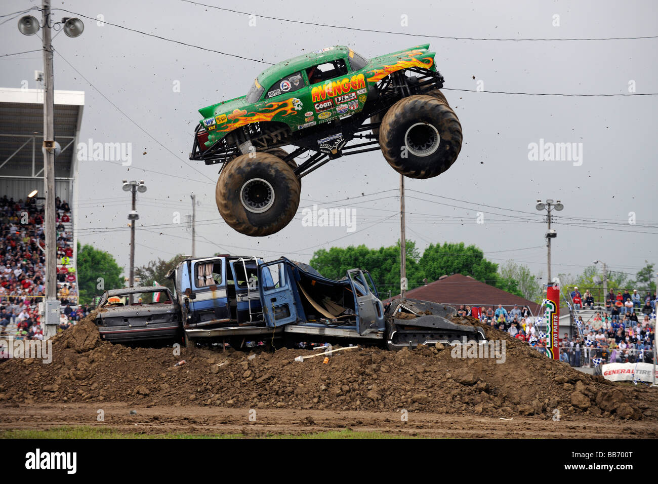 Monster Truck Jumping Crushed Cars In A Race Stock Photo Royalty