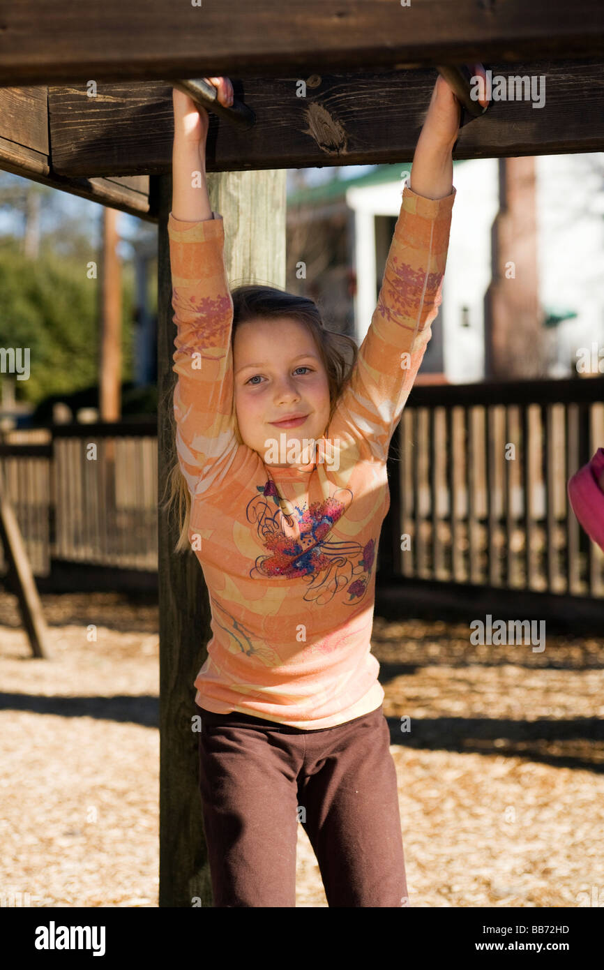 young girl exposed on monkey bars