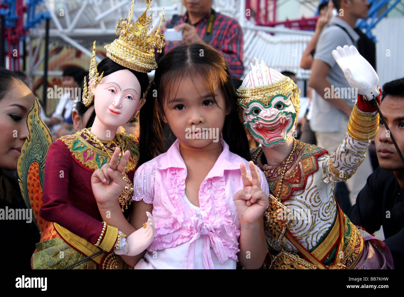 Thai children posing with traditional Thai puppet ...