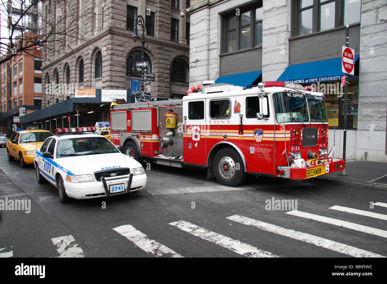 A new york city police car passes a new york fire for Bureau new york