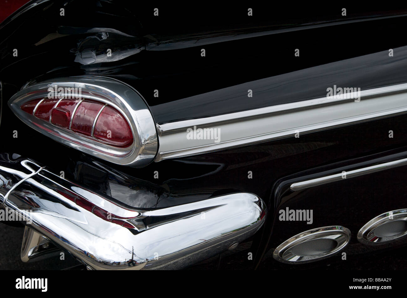 Antique chevy impala tail light with exhaust ports and black paint and chrome bumper stock