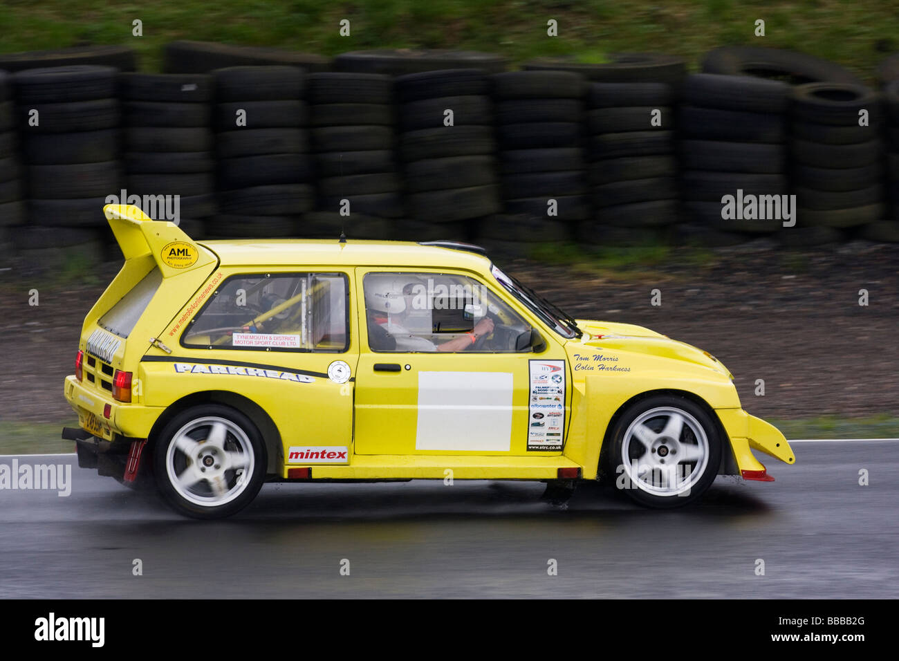 Yellow Metro 6R4 rally car on wet track Stock Photo, Royalty Free ...