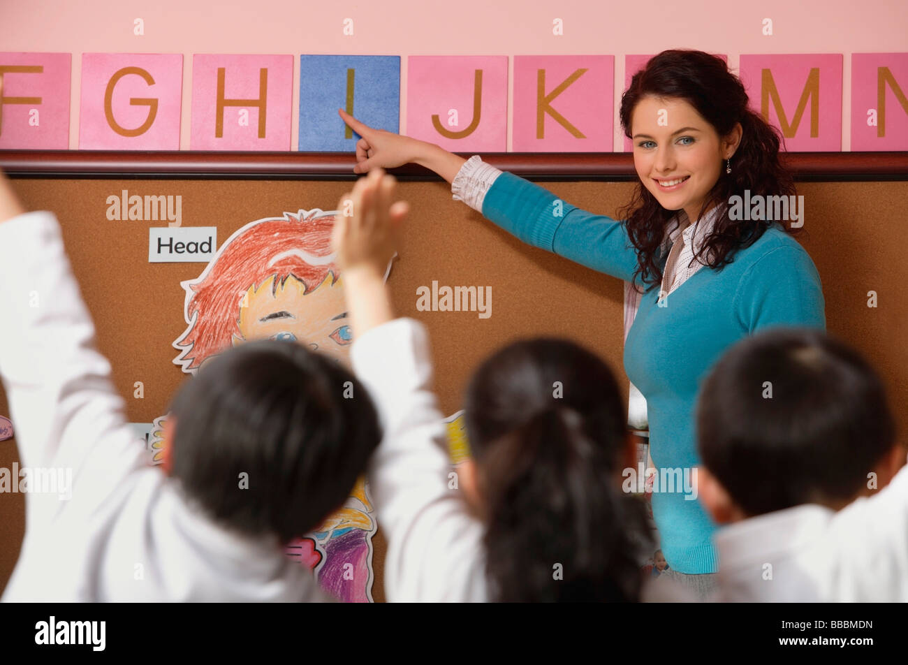 Teacher teaching alphabet in class Stock Photo, Royalty Free Image ...