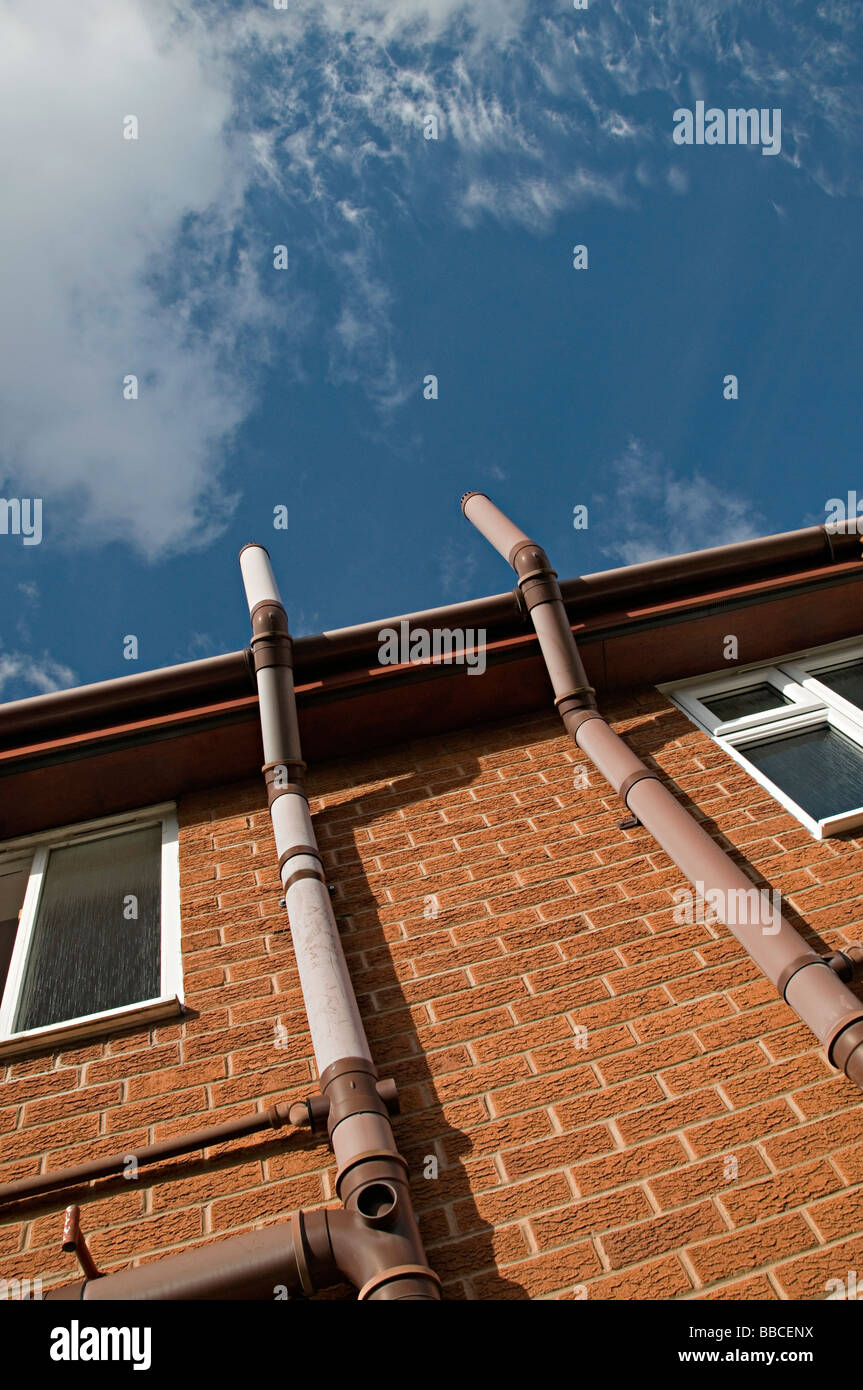 a ventilation pipe on a modern house that lets gases from the