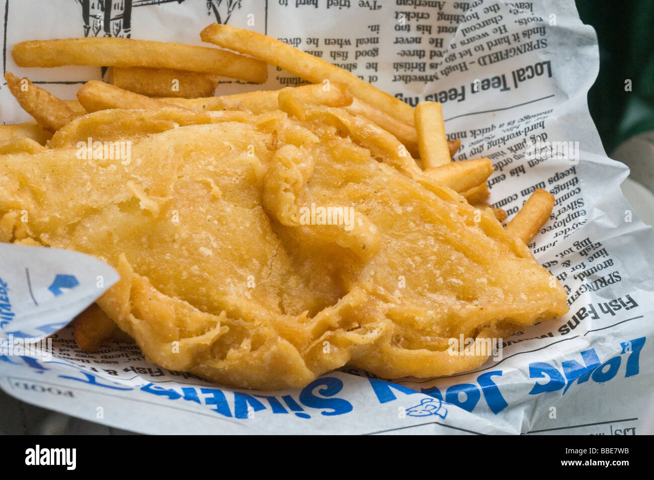 Fried fish and chips on newspaper stock photo royalty for Fish and chips newspaper