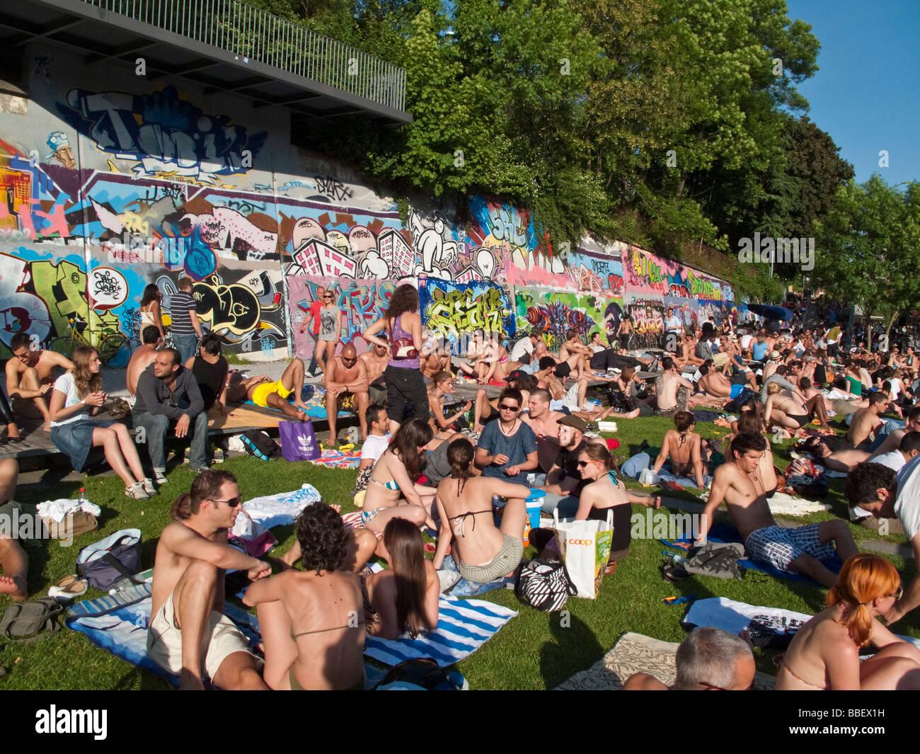Open air bath Letten at river Limmat people sunbathing Zurich Switzerland. Open air bath Letten at river Limmat people sunbathing Zurich