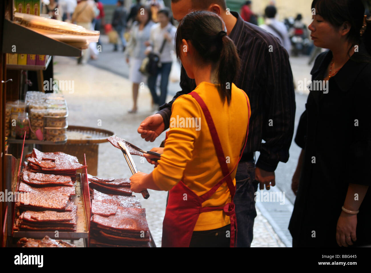 Street Hawker Selling Sheets Of Spiced Meat Stock Photo ...
