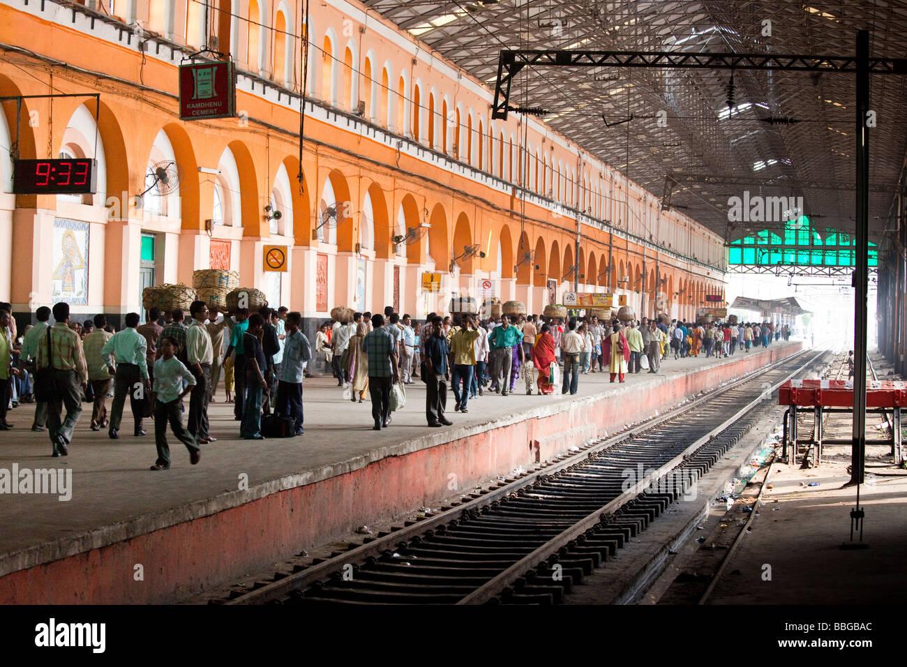 Passengers Wait On The Platform At Sealdah Railway Station