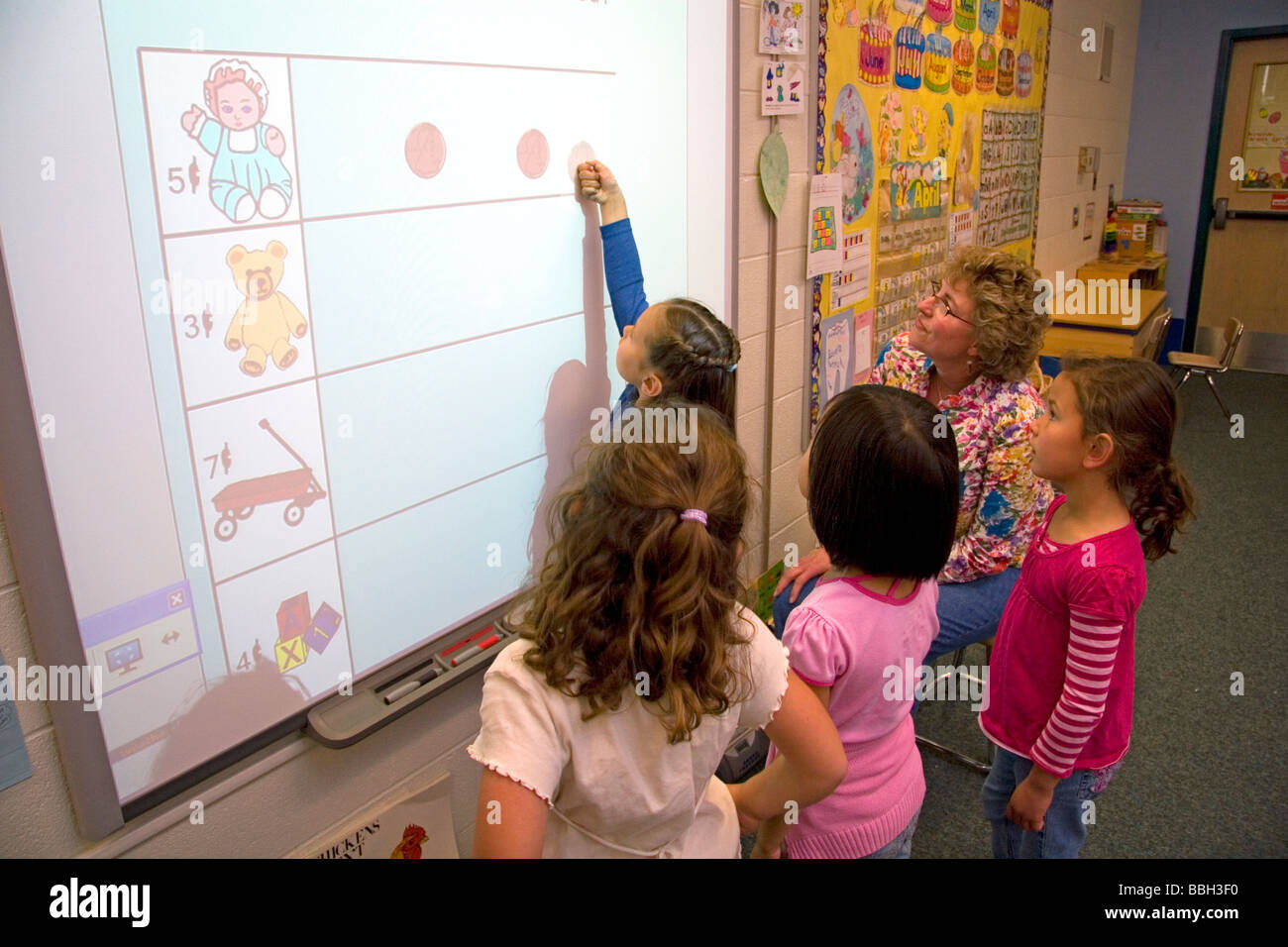 Kindergarten Calendar Interactive Whiteboard : Kindergarten students use an interactive whiteboard in the