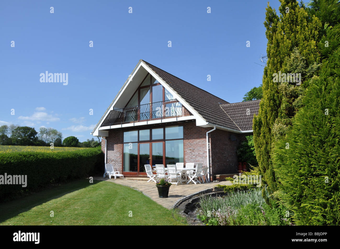 Modern house and garden - Modern Detached House And Garden In English Countryside