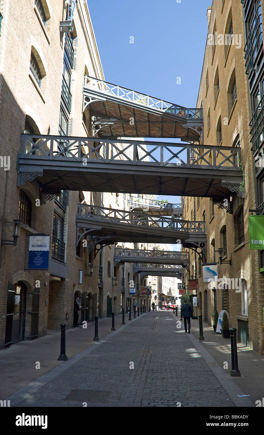 london wharf warehouses with walkways spanning the street Stock