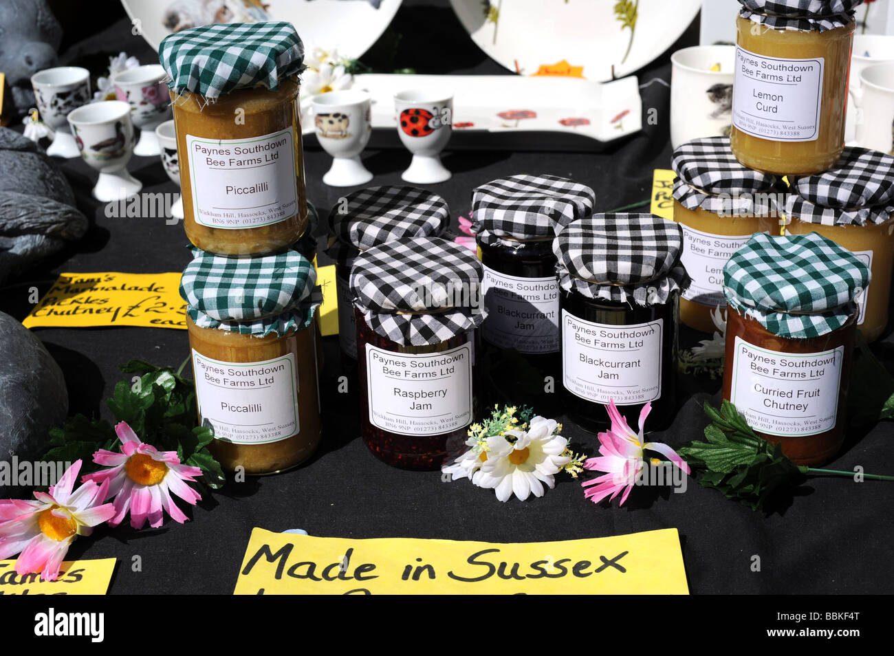 jars of homemade jam and pickles on sale on a stall in. Black Bedroom Furniture Sets. Home Design Ideas