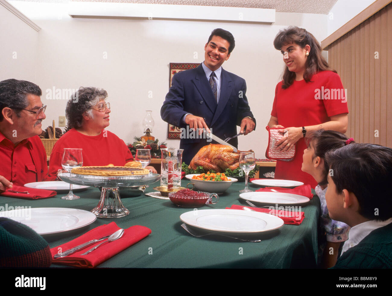 Hispanic Family Holiday Meal Thanksgiving Christmas Turkey Dinner Eat Share Love Enjoy Happy Fun Celebrate Child Grandparent