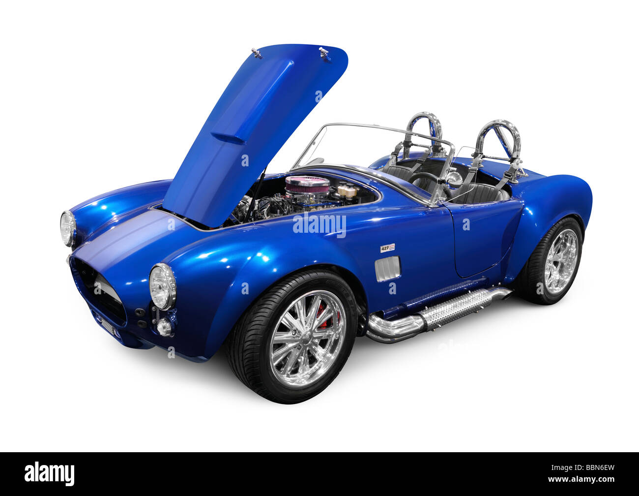 Some Shelby Cobra 427 classic car parks in a forest track drive ...