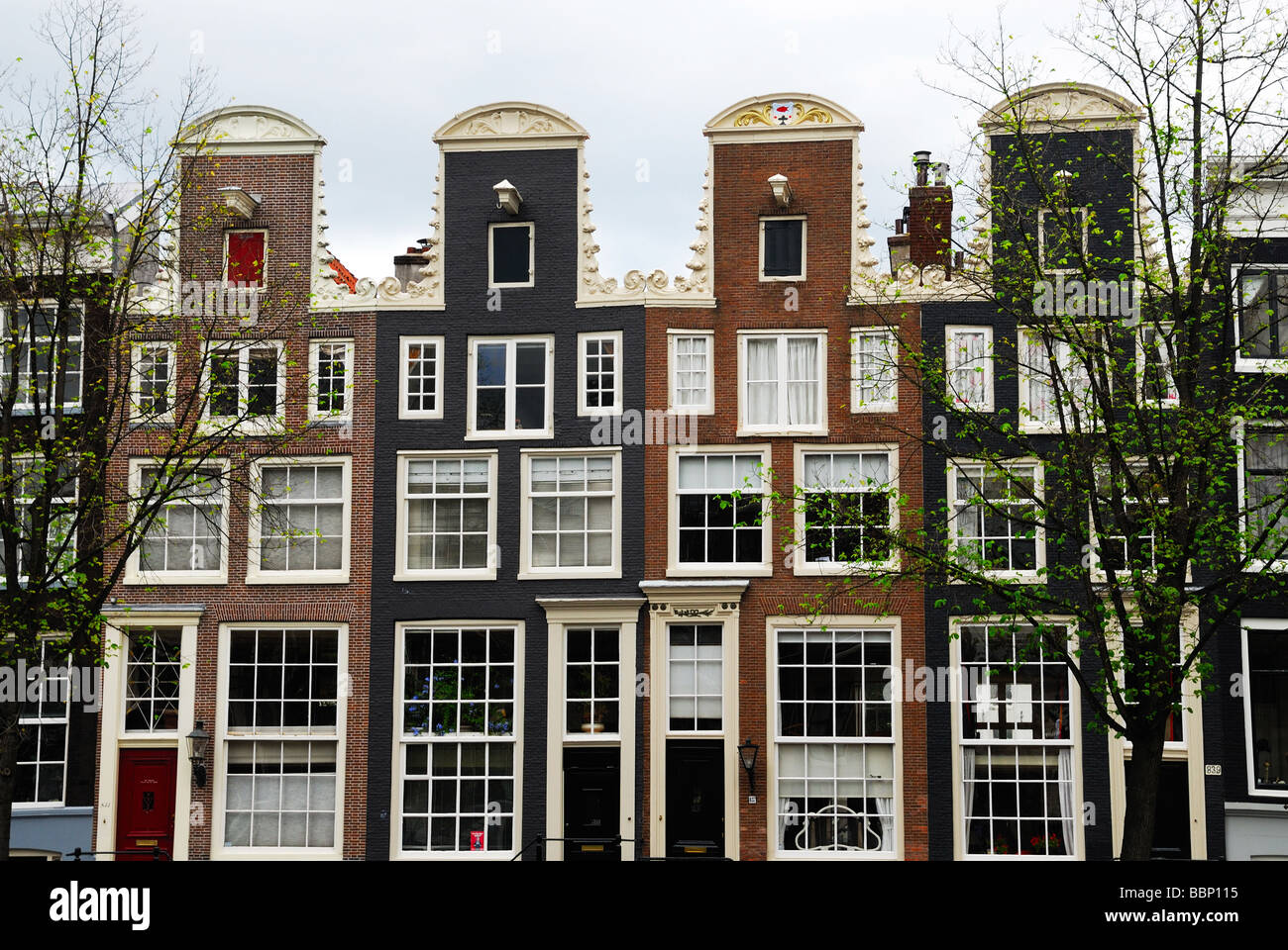 Typical Dutch houses along the canal in Amsterdam The