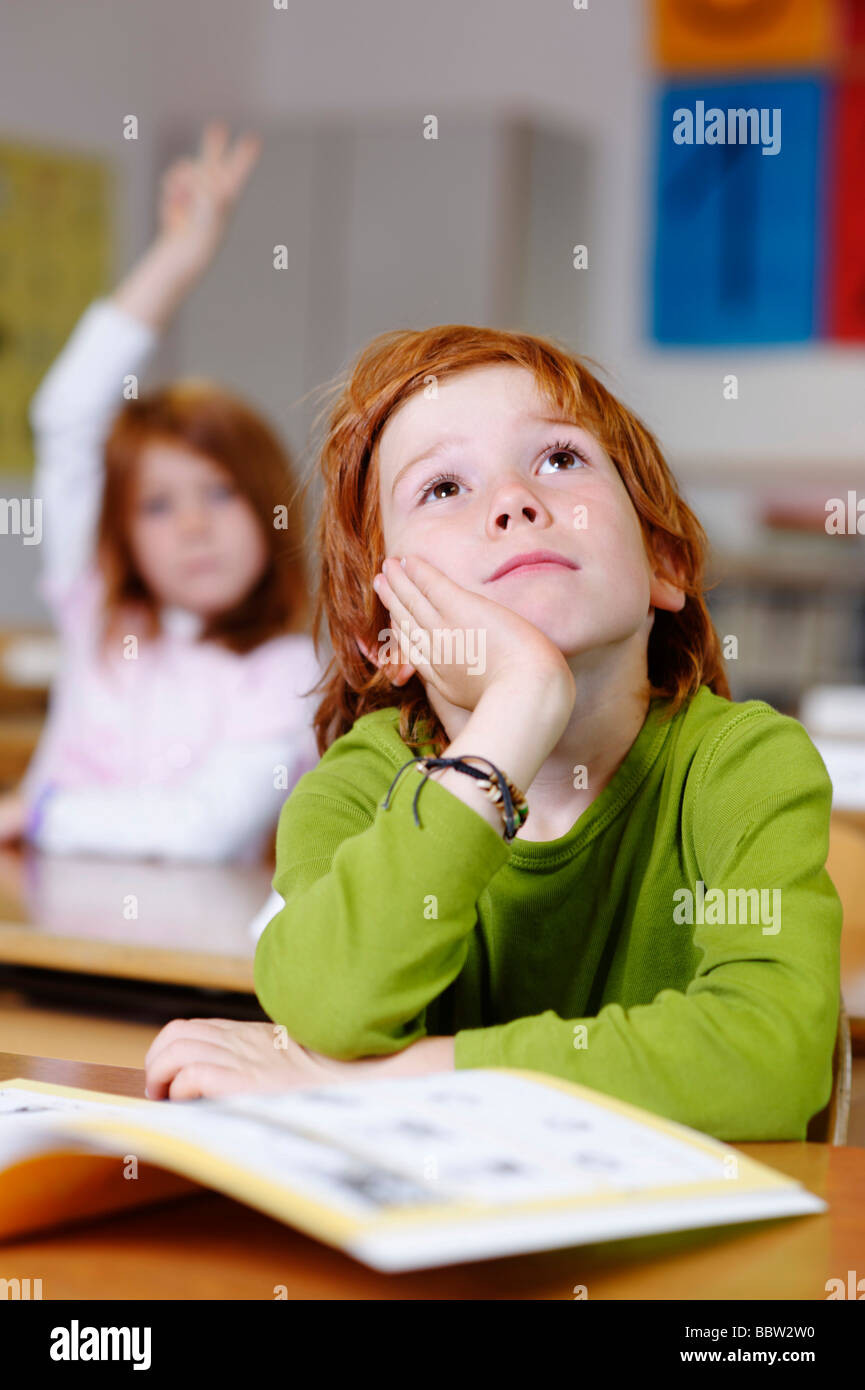 Children In A Classroom In Primary School, Boy Daydreaming ...