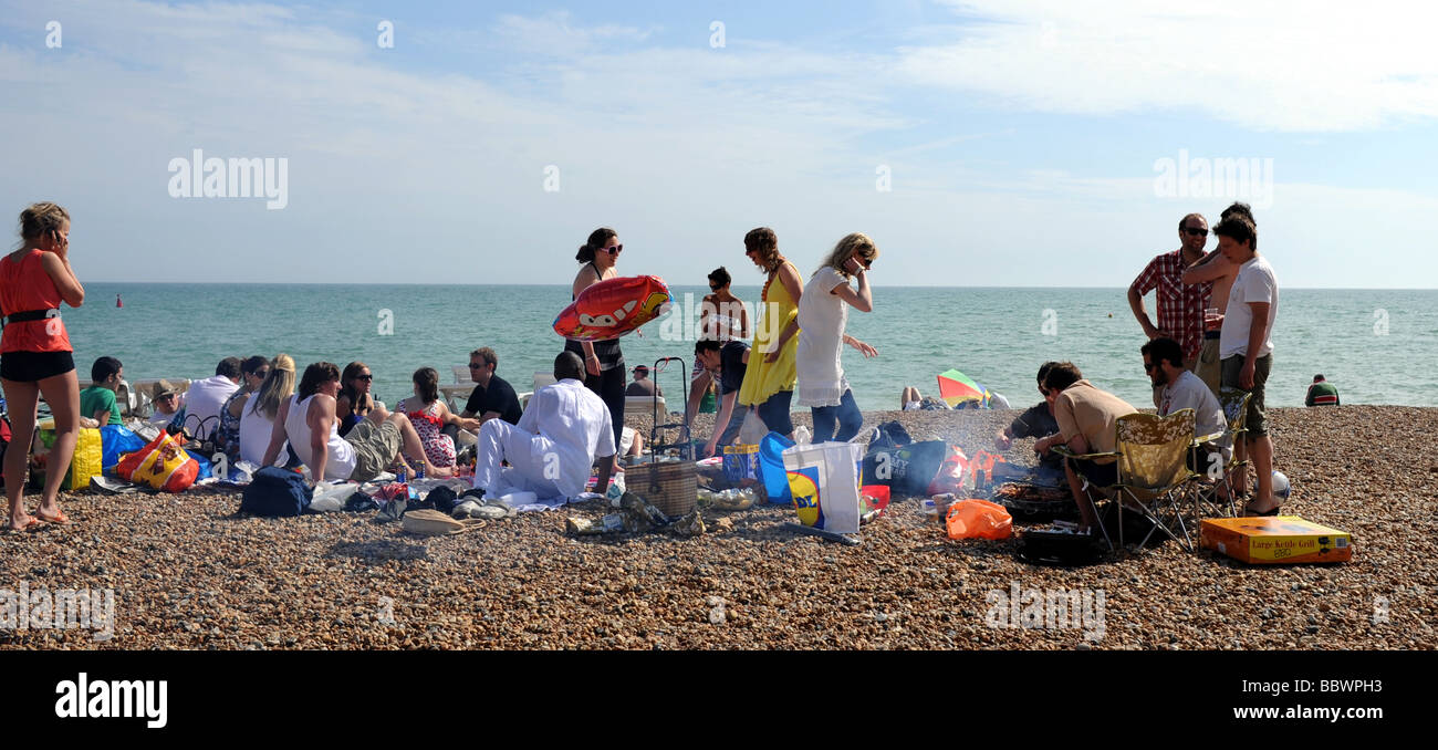 beach with people partying. group of people enjoy a barbecue party on hove beach in sussex uk 2009 stock with partying 0