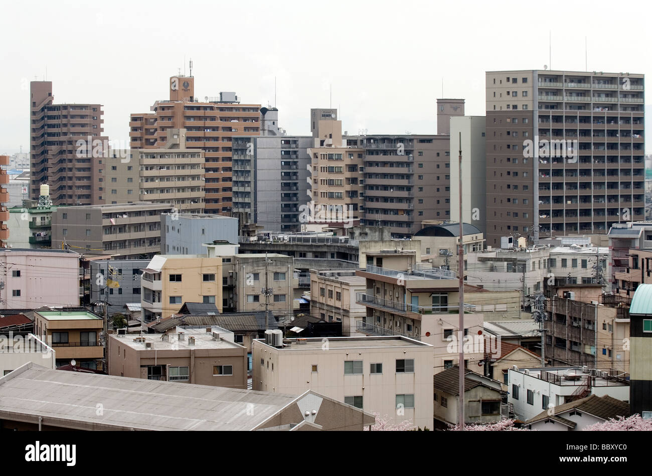High Rise Apartment Buildings Create A Backdrop To A Sea Of Small - Small apartment buildings