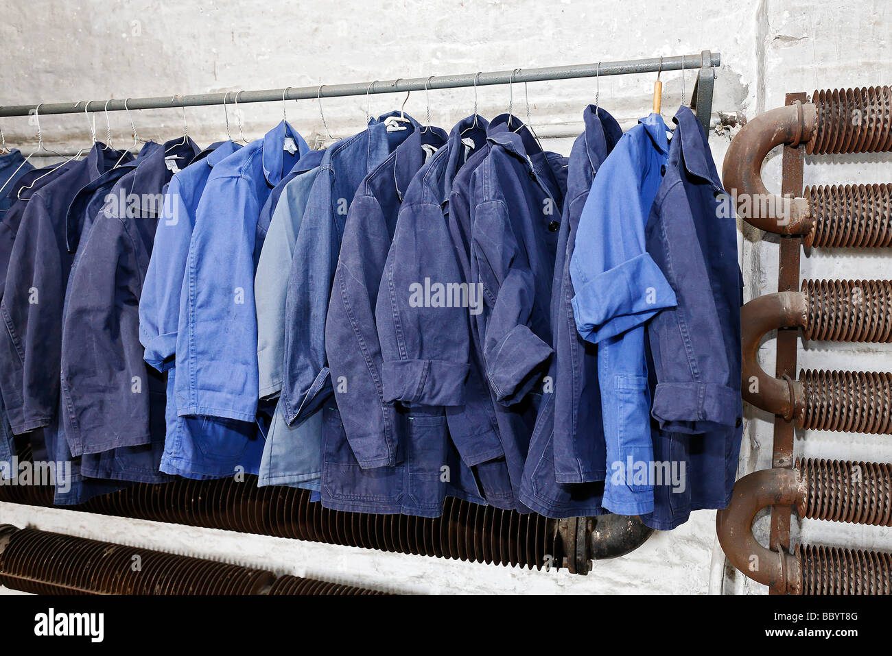 Blue work clothing hanging on a pole former locker room for Locker loop dress shirt