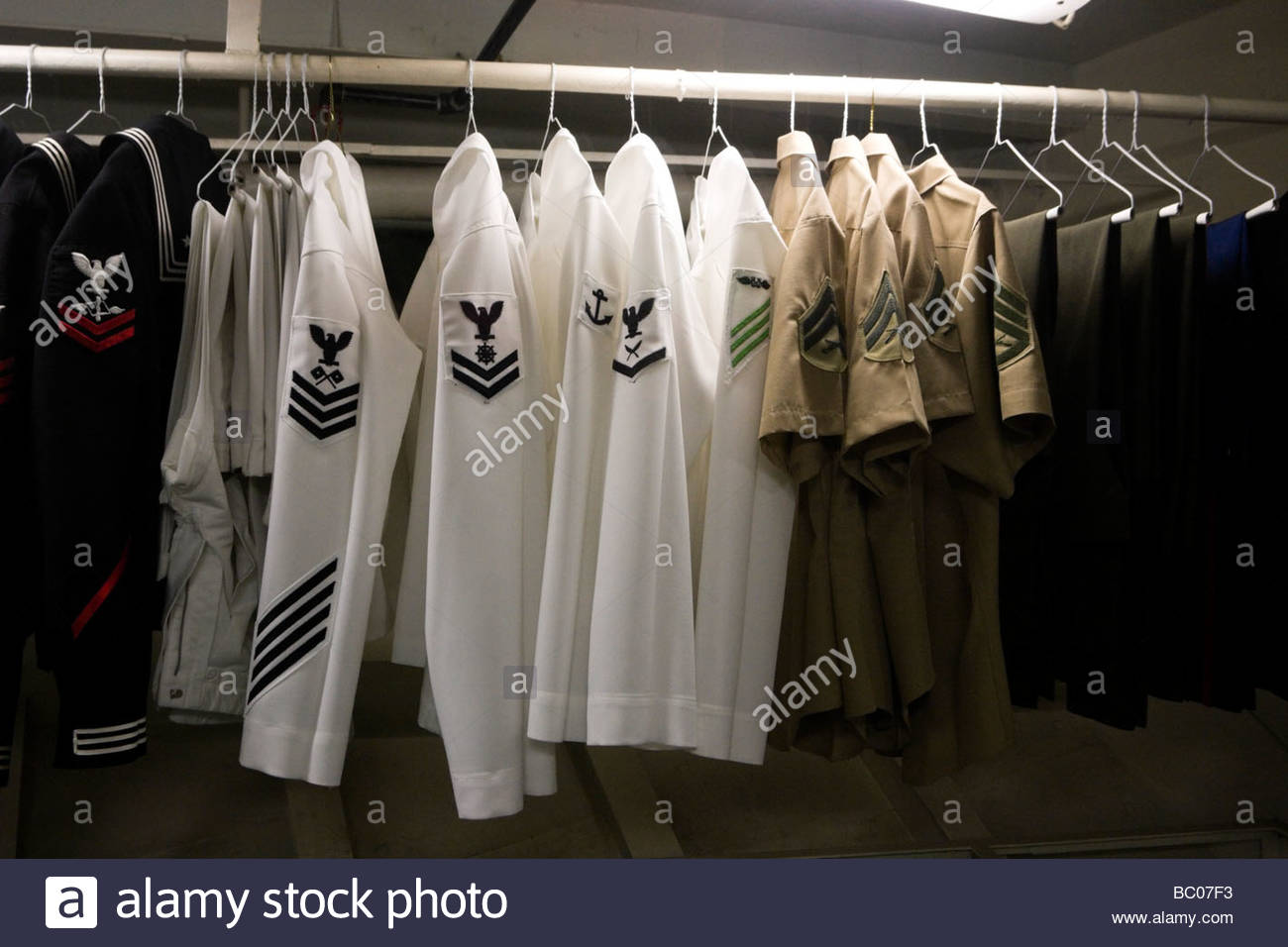 Stock Photo   US Navy Uniforms Hanging In Closet USS Midway Museum San Diego  California