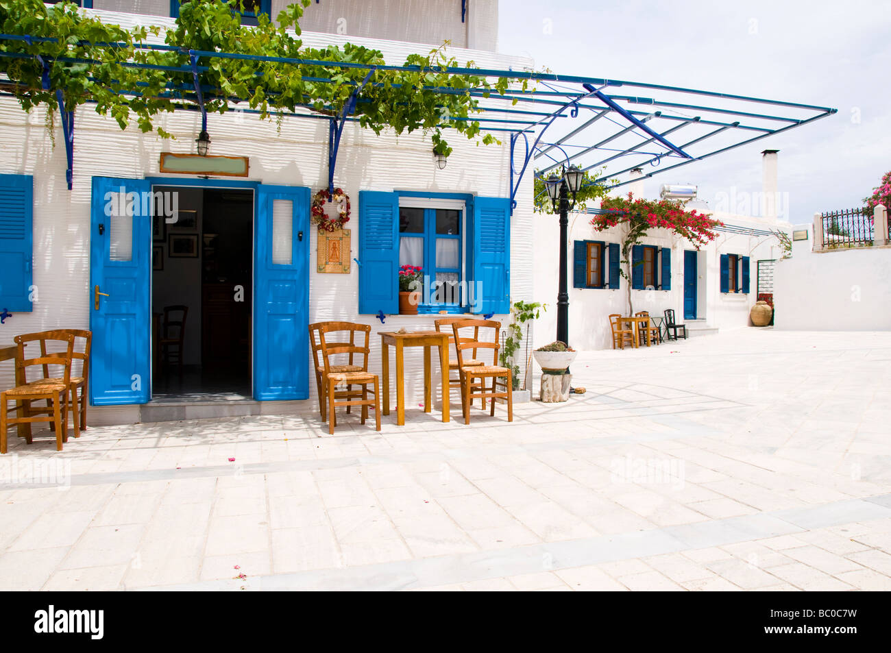 Cafe greece outdoor restaurant coffee shop greek islands paros cafe greece outdoor restaurant coffee shop greek islands paros lefkes travel furniture chairs table woven seat generic typical c geotapseo Gallery