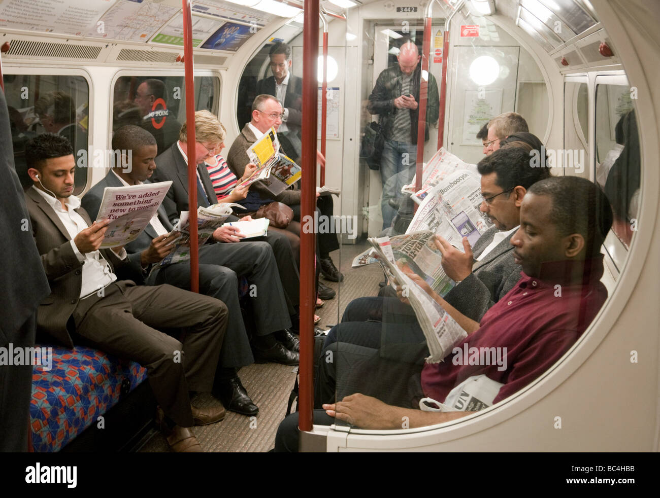 people sitting in the interior of a carriage on a london underground stock photo royalty free. Black Bedroom Furniture Sets. Home Design Ideas