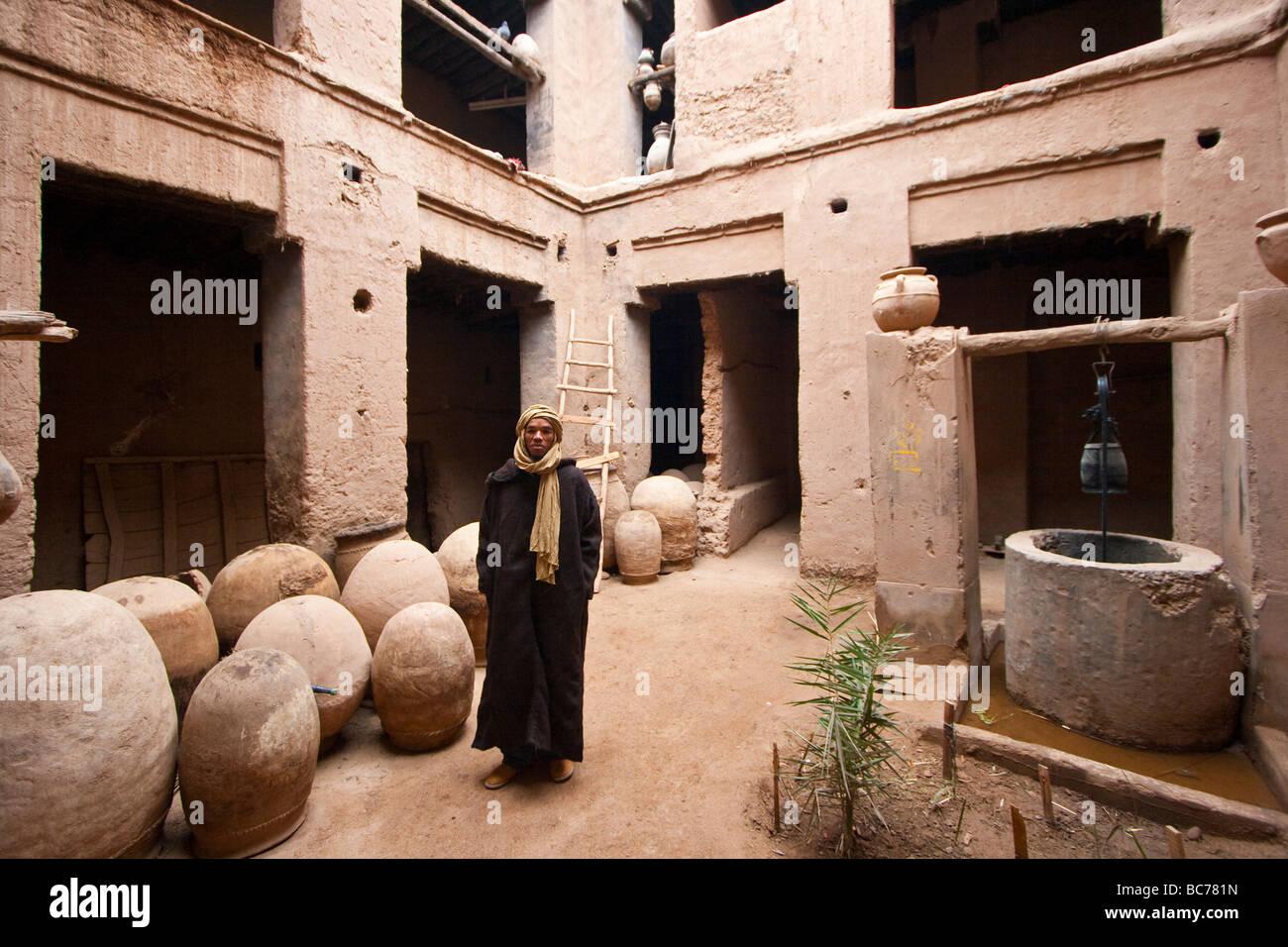 Moroccan man inside a kasbah in amezrou morocco stock for Morocco motors erie pa