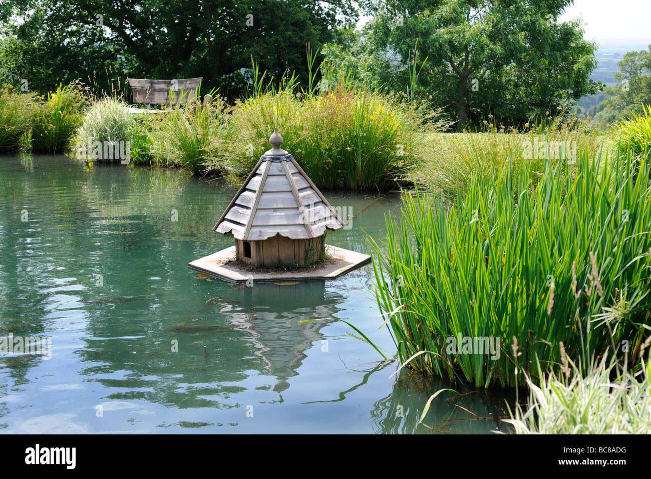 Floating duck house on the lake of a landscaped english for House duck