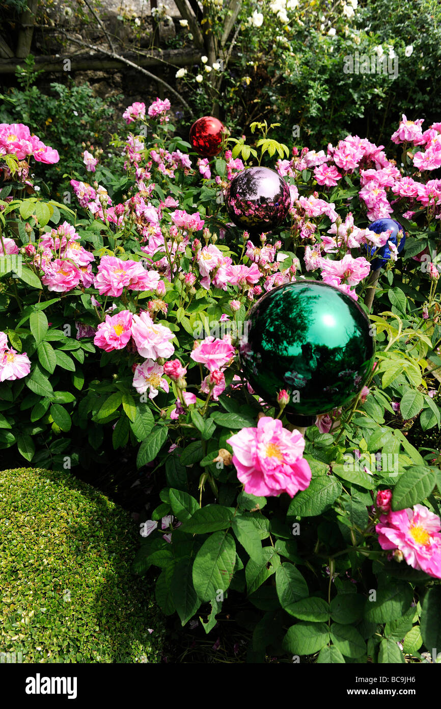 Flowers and decorative coloured balls in an English Garden in Stock ...