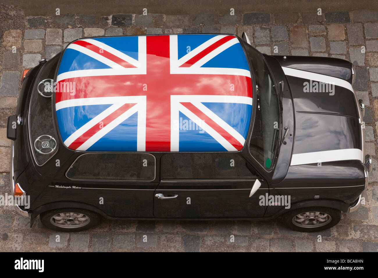 Design of car jack - Europe Union Jack Painted On Roof Of A Black Mini Car From Above