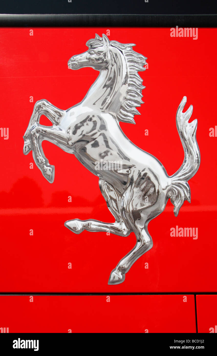 Ferrari prancing horse logo on a red racing car stock photo close up of the ferrari prancing horse logo on the side of a formula one transporter biocorpaavc Gallery