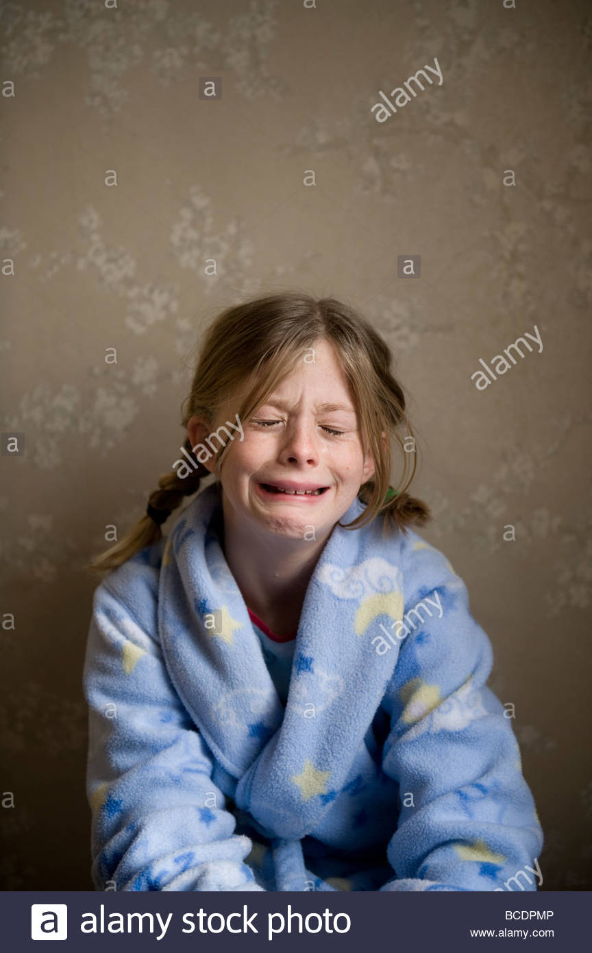 A 10-year-old girl cries in her pajamas Stock Photo, Royalty Free ...