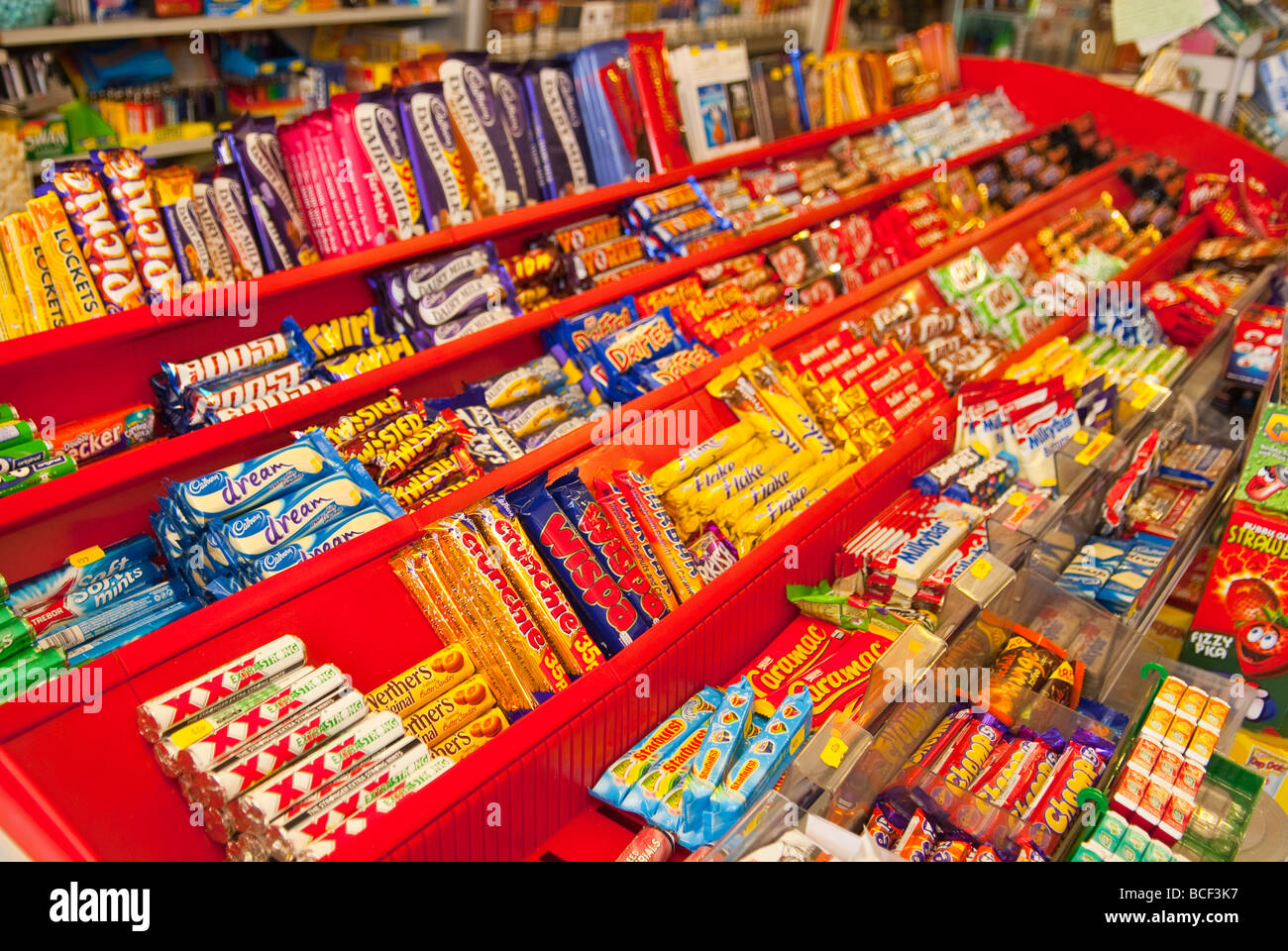 Chocolate bars and sweets for sale in a Uk sweet shop store Stock ...