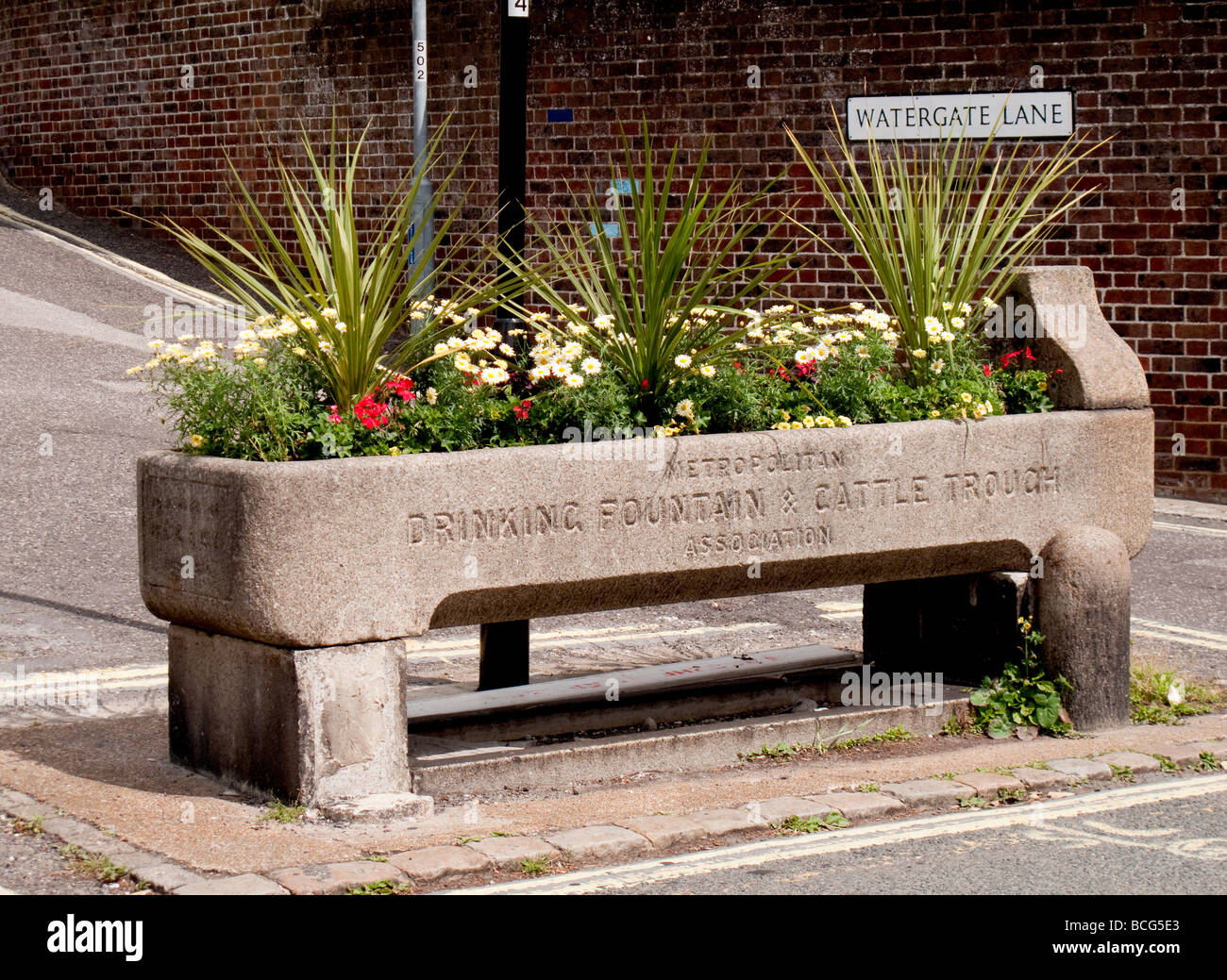 A Horse Trough Planted With Flowers Stock Photo, Royalty
