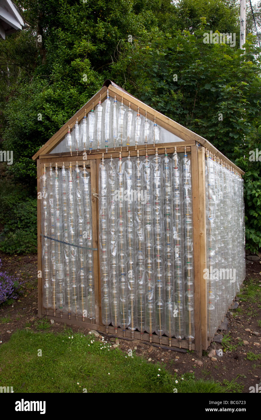 recycle greenhouse made from reused plastic bottles forming exterior walls of garden shed as a
