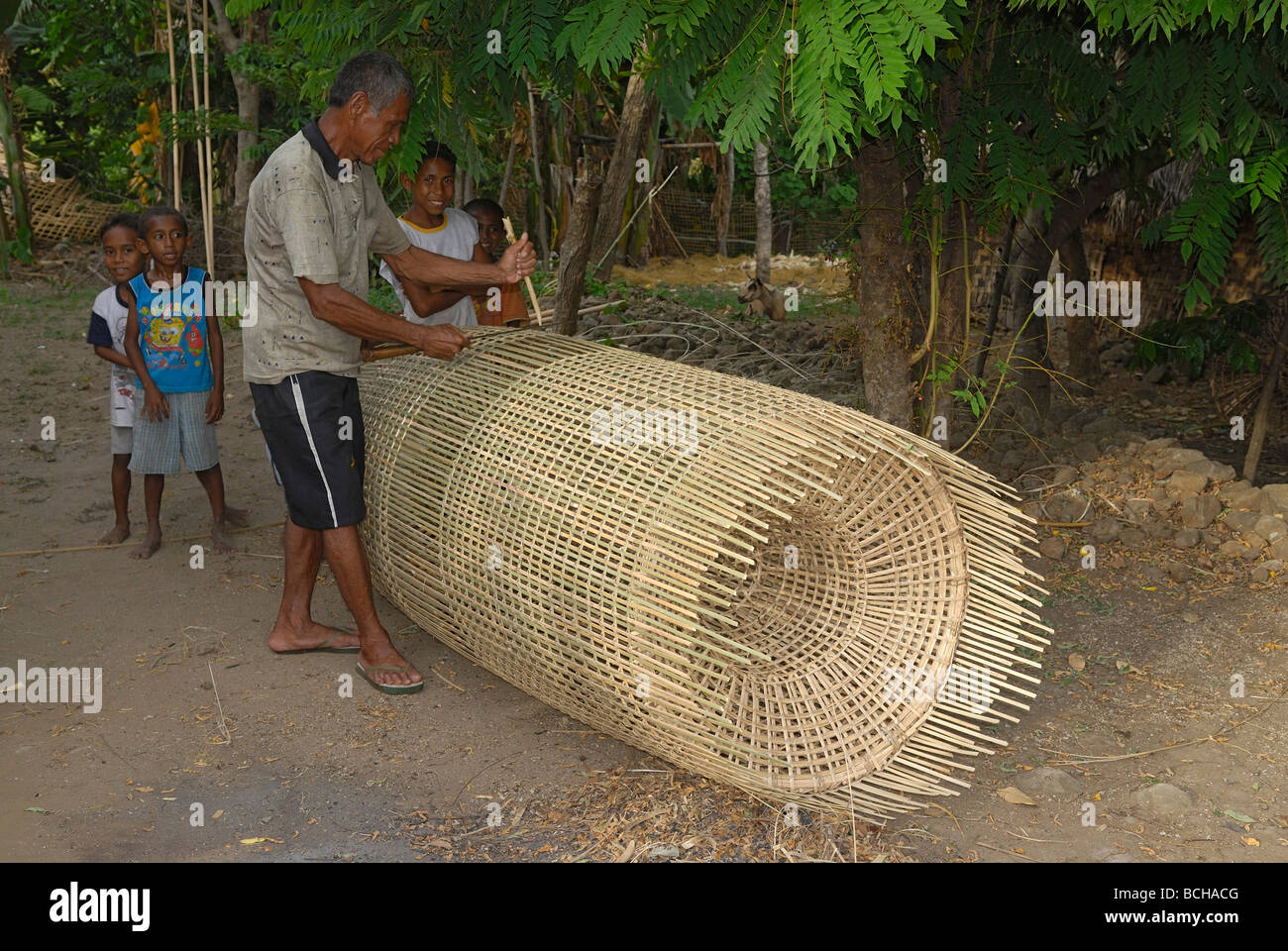 Fisherman making fish trap on pantar island alor for Fishing net for sale