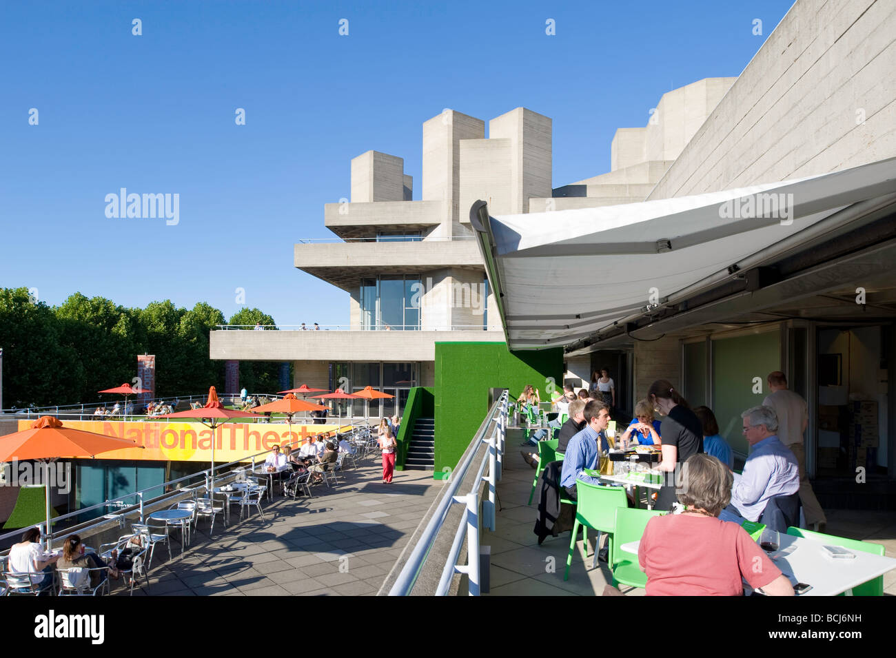 people relax on terrace bar of royal national theatre