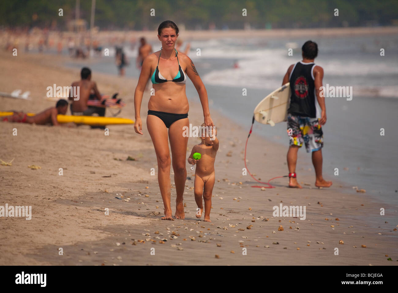 child naked  Child Baby Care Mother Ocean Sea Naked Beach Fun Bali Kuta .